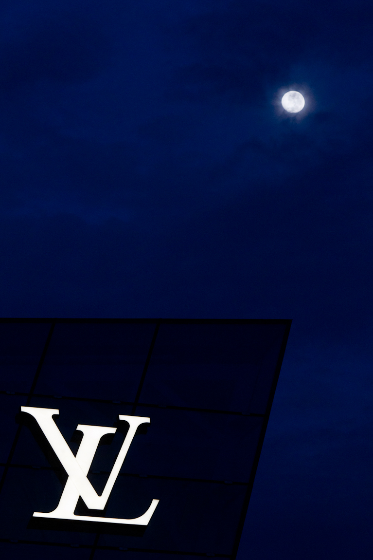 I found the moon in the pre-dawn sky this morning while walking out along the boardwalk near the Louis Vuitton store at the Marina Bay Sands in Singapore.