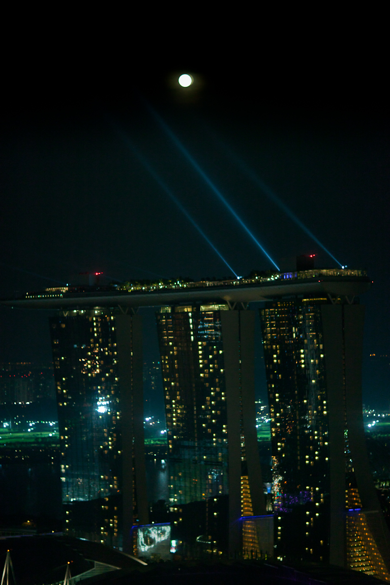 The moon put in a guest appearance behind the Marina Bay Sands, Singapore last night in time to be part of the nightly 8 PM light and music show. I didn't anticipate the event and had to scramble to get a camera ready to record the scene through my living room window.