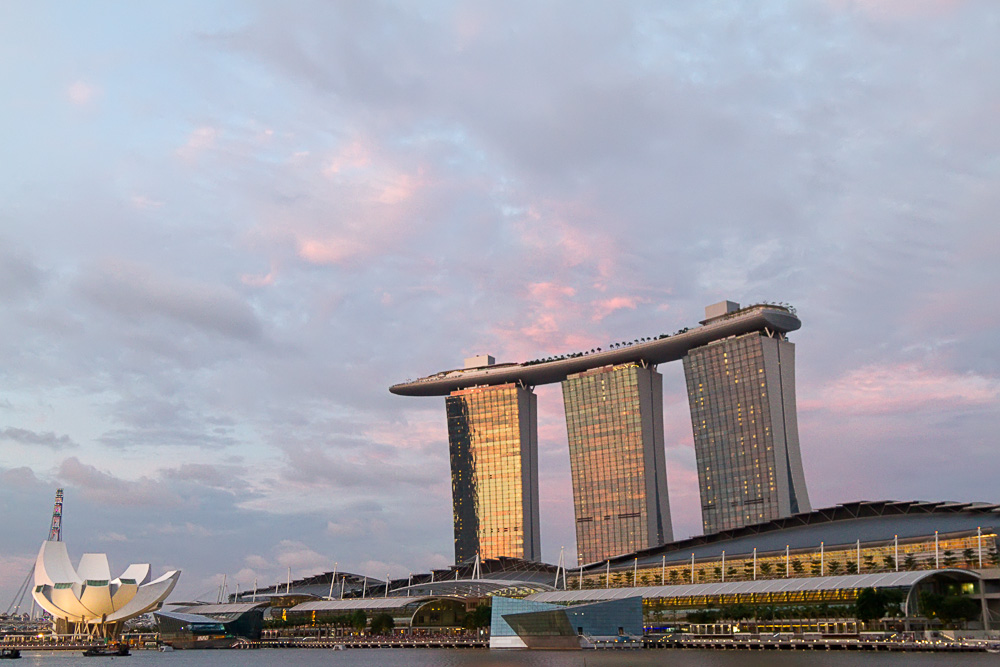 I went to the area around Customs House at Marina Bay to watch and photograph the Singapore National Day 2011 practice session. After looking through the images again, I concluded that this image showing the soft colors in the clouds above Marina Bay Sands taken right around sunset was my favorite.