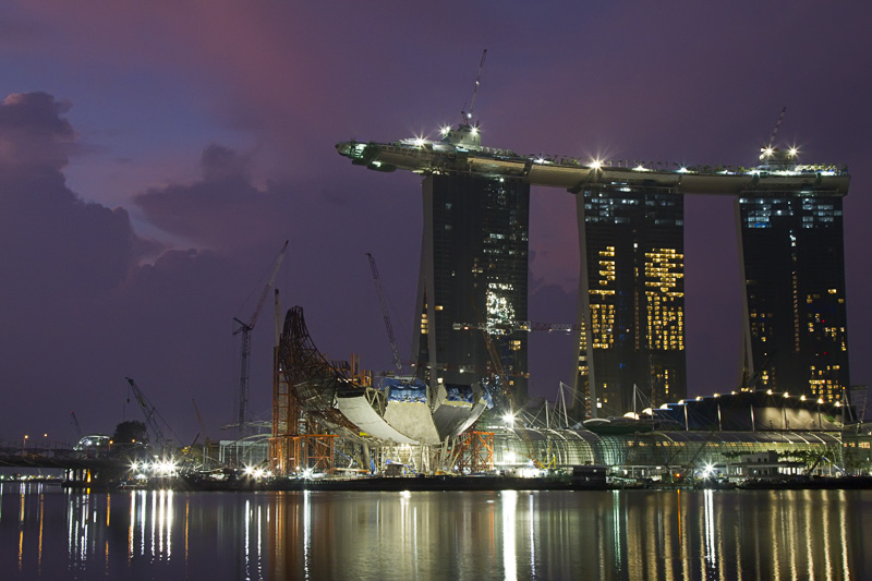 We arrived back home about 5 AM from Tokyo and Portland and I took my camera and tripod out for a walk before sunrise. As the sky began to show a little color I noticed the billowing clouds in the sky behind the Marina Bay Sands casino and tried a few frames. Below is the one I selected to post. (Note this image needed to be run through Imagenomic Noiseware Professional to remove a rather intrusive amount of noise, something I don't usually need to do with these low light images).