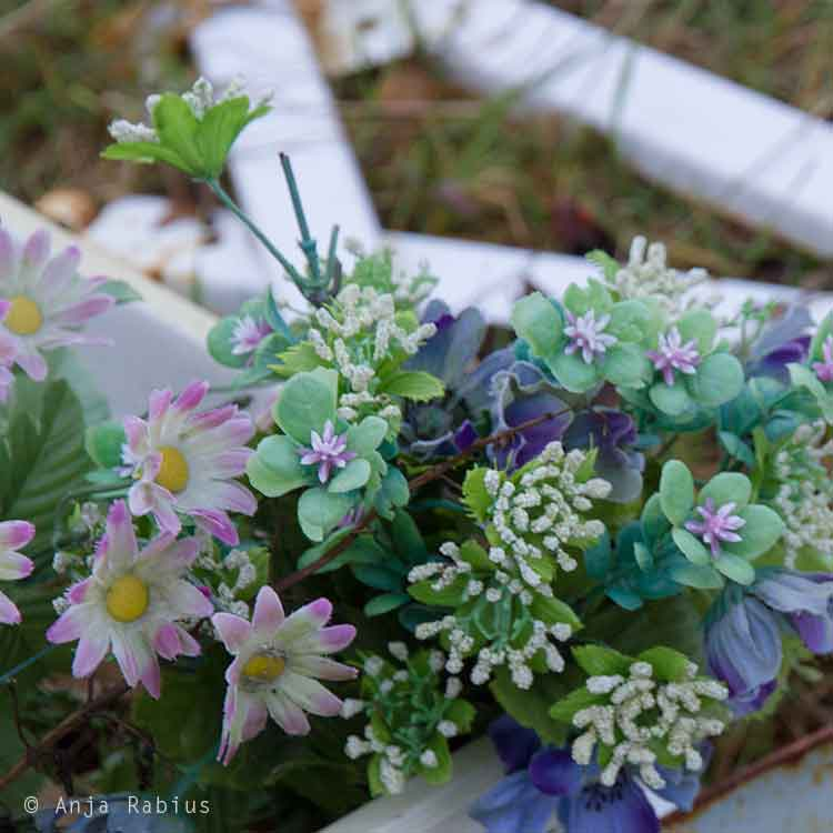 Abandoned artificial flowers.