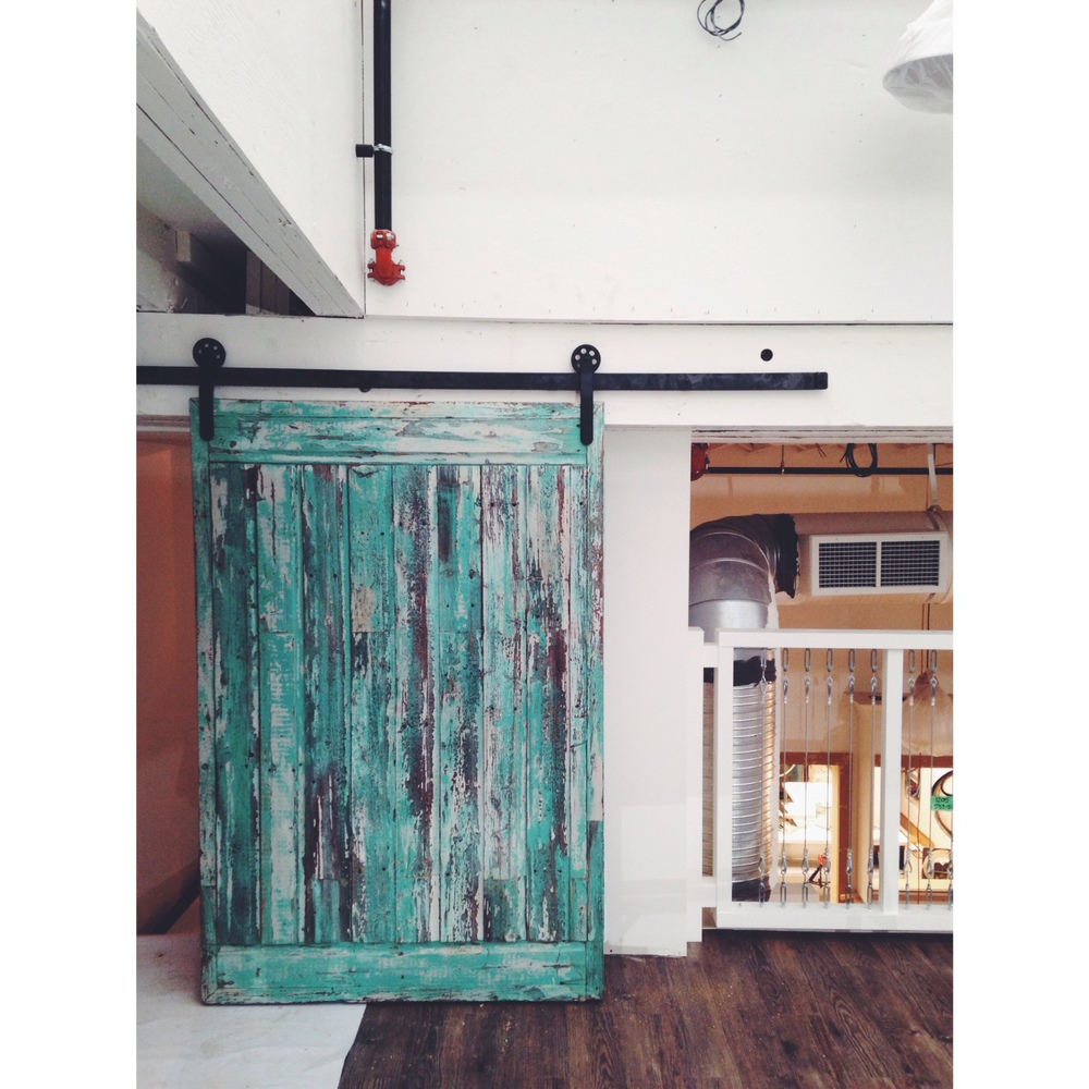 Sliding barn door and hardware from Salvage Solutions.  Picture Dustin LeClerc.