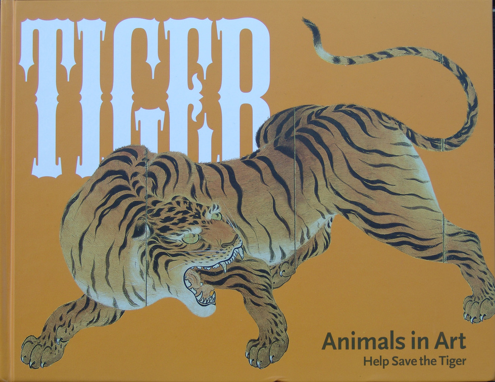 Book about tigers containing section on wildlife artist Eric Wilson.