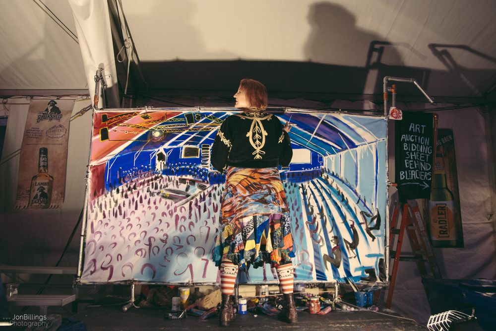 One of the live artists in the tents.