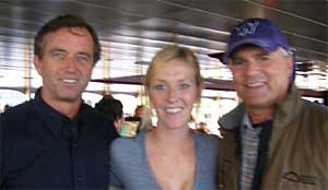 Former SRK Program Director, Allison Albert (center), poses with Bobby Kennedy, Jr., (left). and friend at a recent Waterkeeper Alliance annual conference in Seattle, WA.