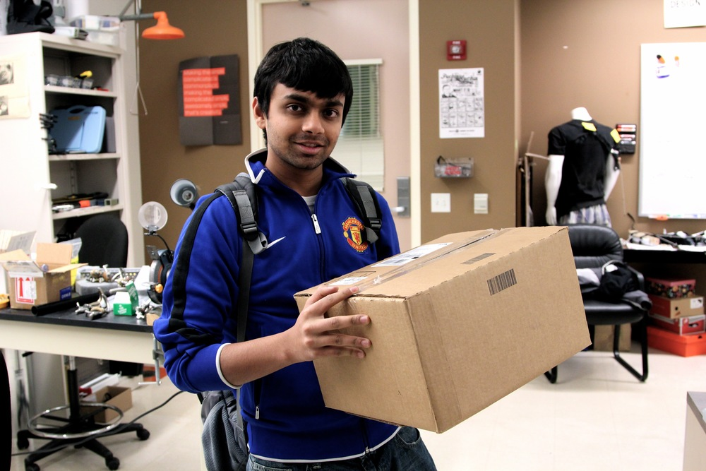 Sudeep holding a prosthetic clinic in a box