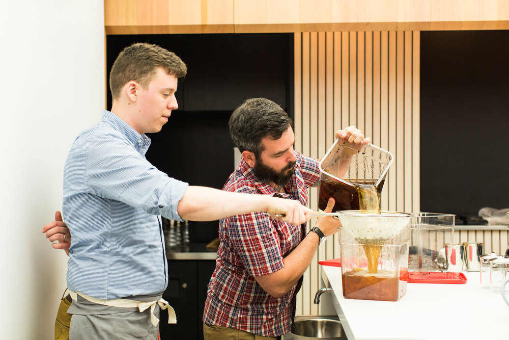 Collin Moody and Ryan Burk filter the cascara cider