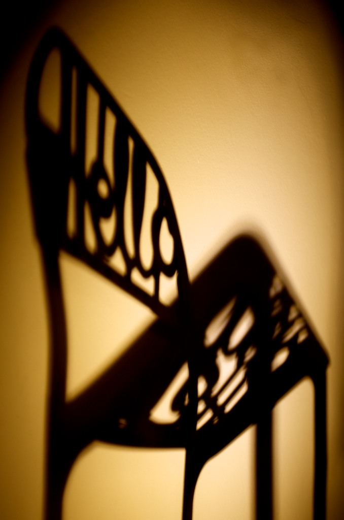 Shadow of the chair on white wall