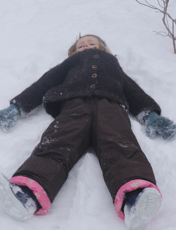 Stopping for a snow angel is crucial to Aneliese; she has a tendency to flop in random spots to make them.