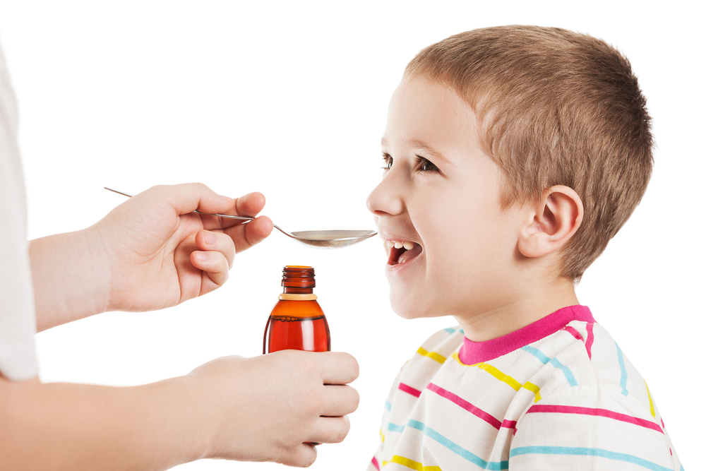 bigstock-Doctor-hand-giving-spoon-dose--42334327.jpg
