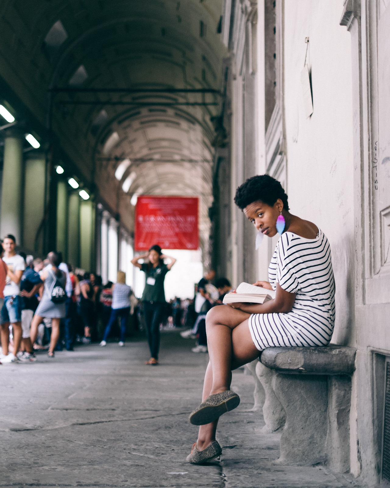 """Marcia working on her Clair Huxtable """"I ain't playing"""" glance just before heading to the Galileo Museum. She told me I had to wait 30 minutes while she relaxed and read."""
