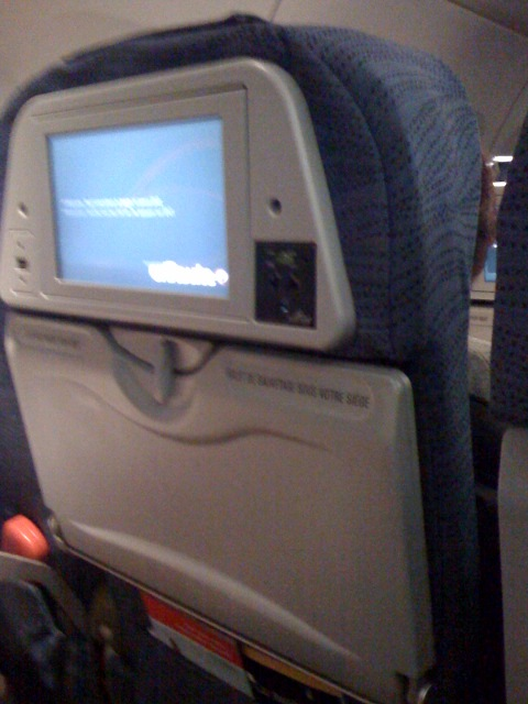 Air Canada has plugs in the back of the head rest