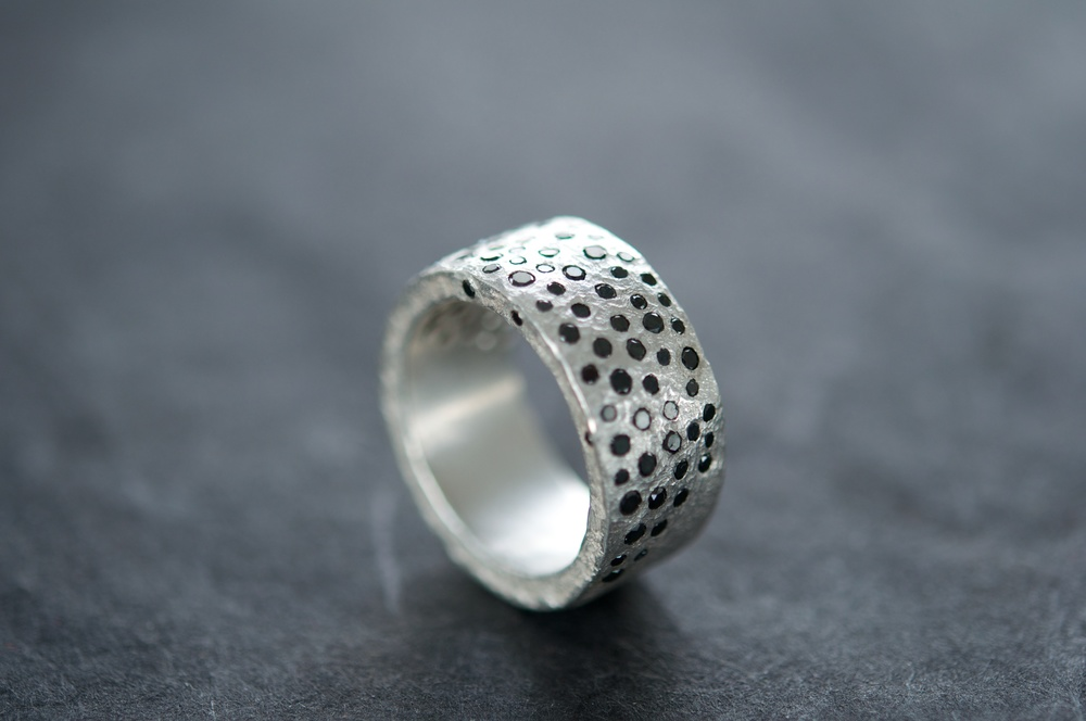 Fine Silver Ring with over 80 black diamonds. I lost count.
