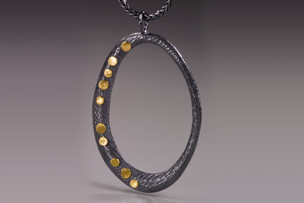 Gold & Silver Hoop Pendant $450
