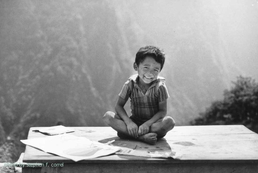 ARR nepal 84 kid on table (1 of 1).jpg