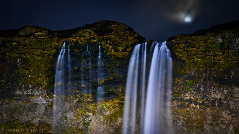 Moonrise over waterfall.