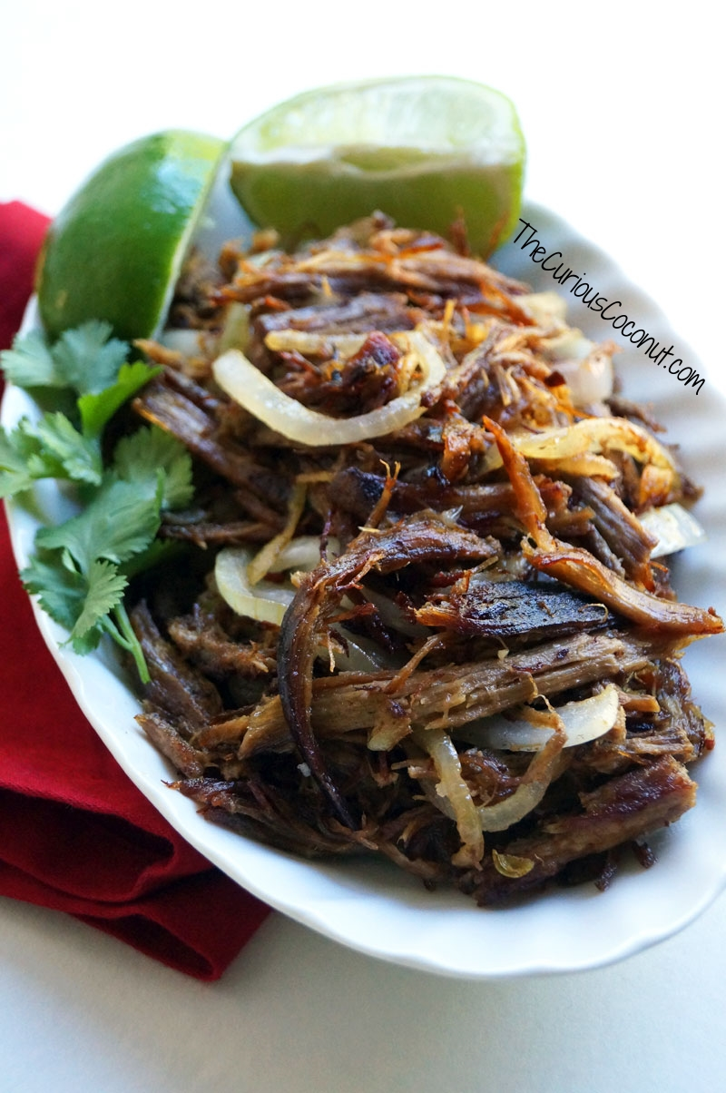 Slow cooker Cuban fried beef with garlic, limes, and onions (Vaca Frita) // TheCuriousCoconut.com