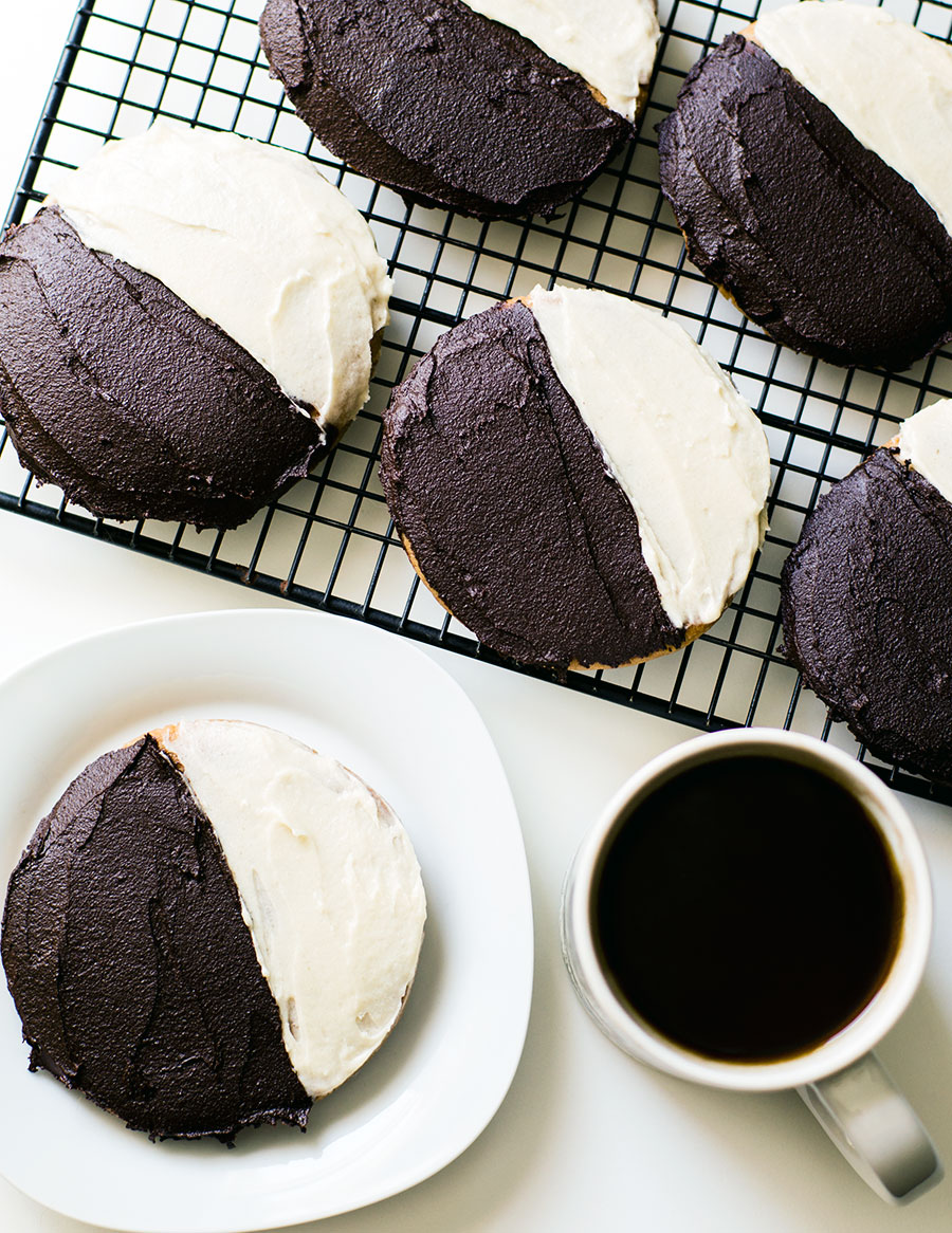 These NYC style black and white cookies are made with #Paleo and #vegan ingredients with an #AIP option and have a soft, cake-like base with fluffy chocolate and vanilla frosting on top!   TheCuriousCoconut  .  com
