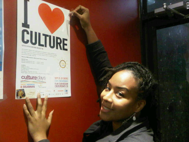 Putting up posters promoting Culture Days upcoming 3 day, across Canada festival.