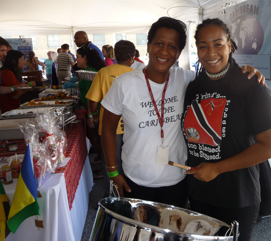Ezra Lataille, committee member of the Caribbean Pavillion, and Suzette