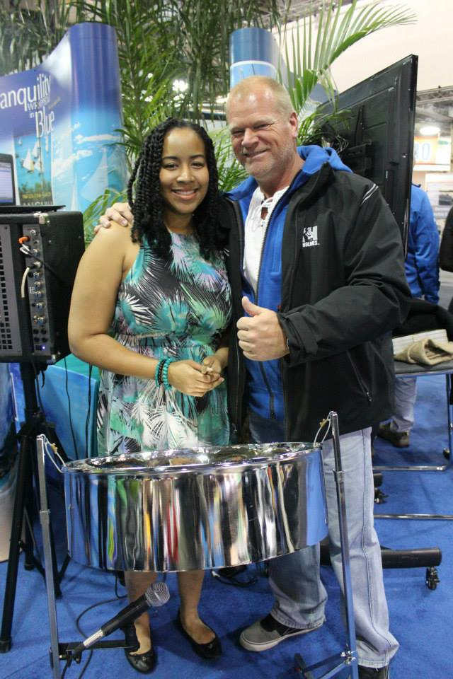 "VIP Night at the ""Eastern Caribbean Village"" for the Toronto International Boat Show. Steelpannist Suzette Vidale & home improvement contractor & television host Mike Holmes"