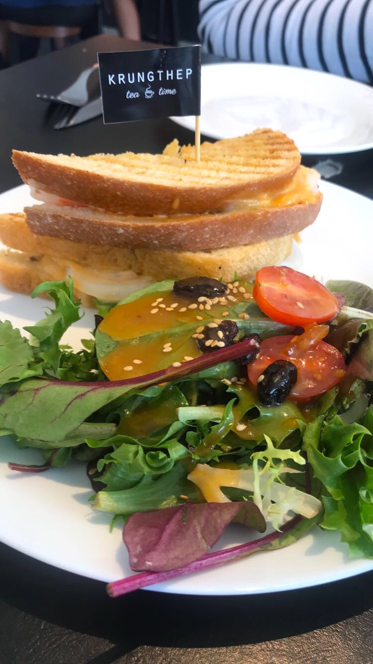 Tomyum Goong sandwich with a sweet ginger-dressed salad