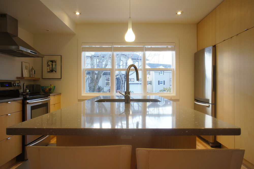 The island was designed so that two could cook and access the sink. It also provides a nice place so sit and watch.