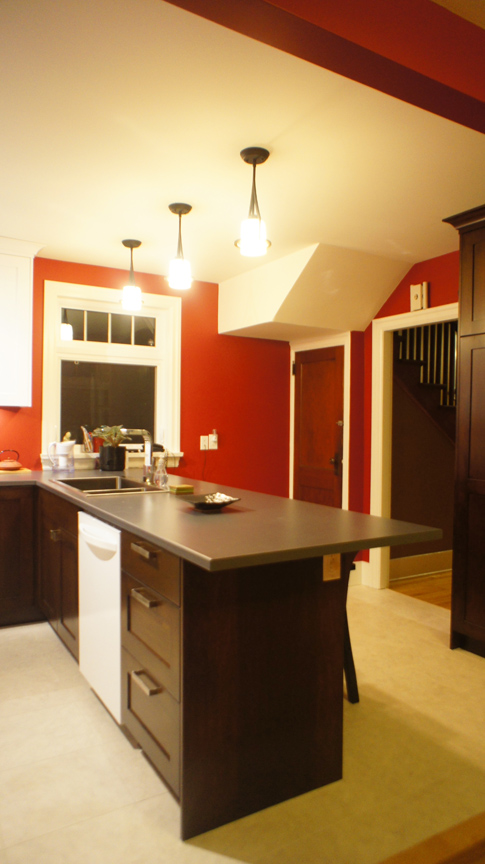 A wall was removed to provide a new open concept kitchen/dining space