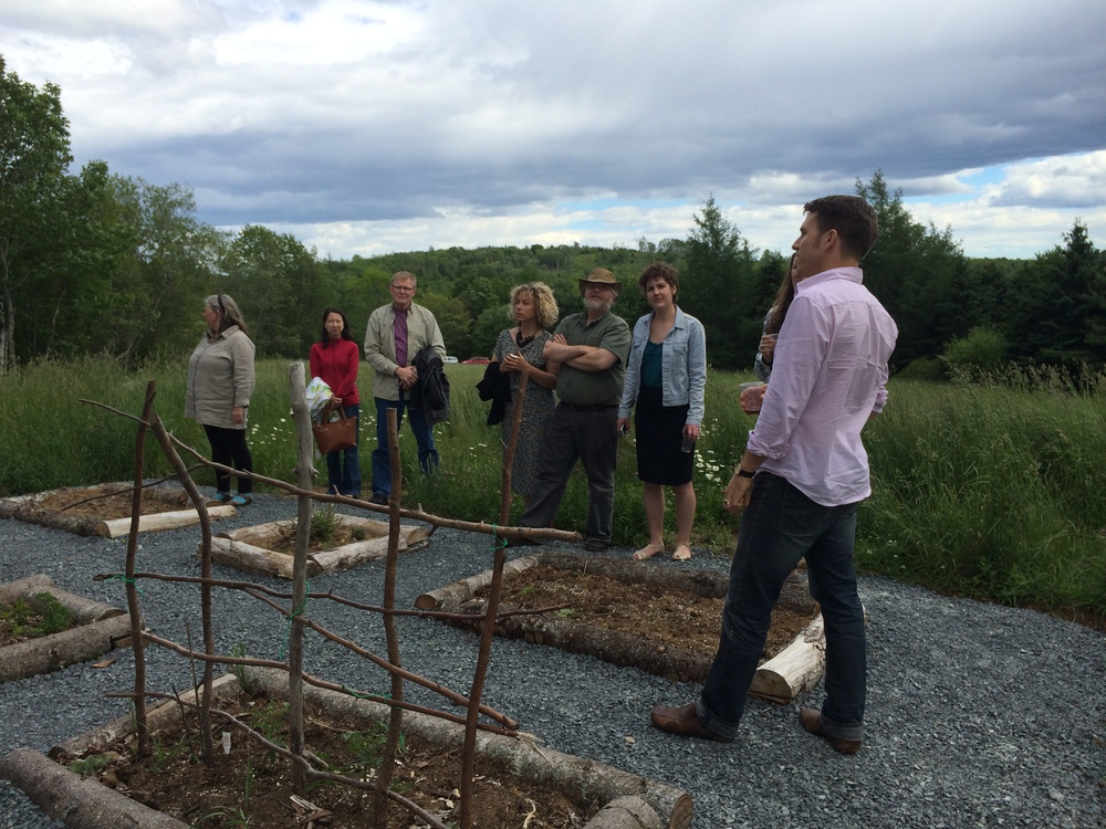 David Gallaugher addressed onlookers amongst the planting beds and field.