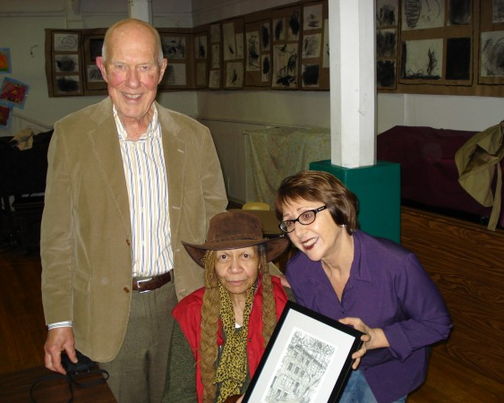 "Pearl Bowser holding her award ""house portrait"" poses with the association's president, Ben Bankson, and vice president, Linda De Rosa."