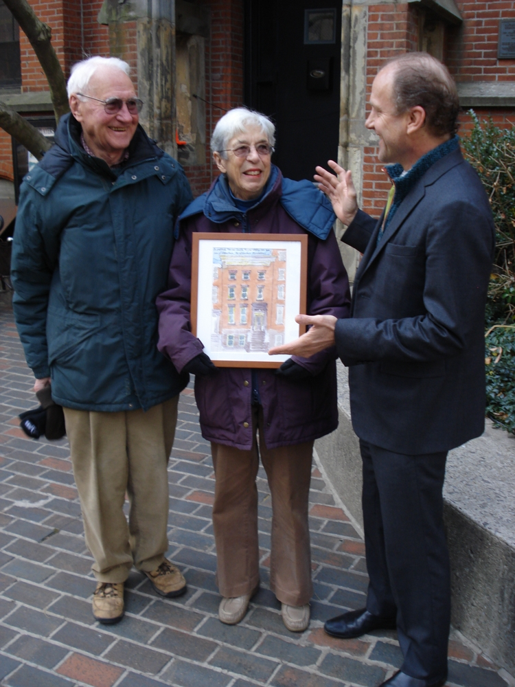 "Peter and Camilla Flemming hold their Alfred Award ""house portrait"" done by Jonathan Marvel, right."