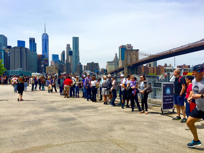 """Visitors queued up to ride the NYC Ferry last summer in Brooklyn Bridge Park. The city is taking steps to ease ferry congestion at the popular destination. Eagle photo by Lore Croghan"""