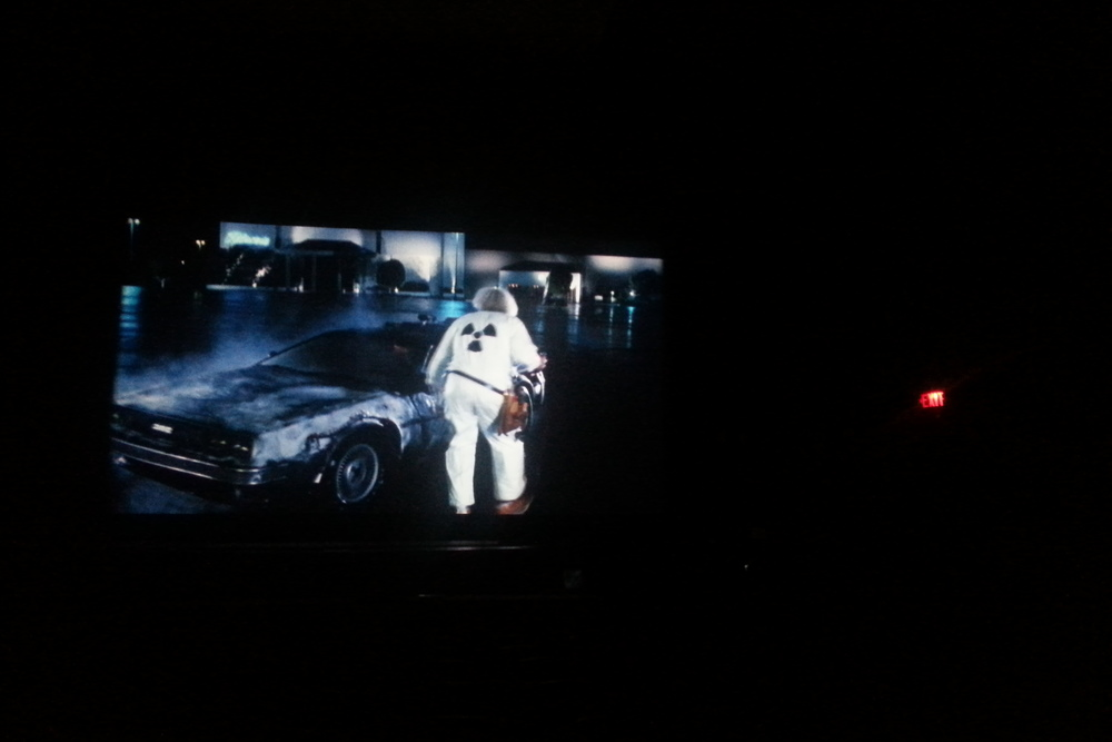 Still from big screen - Doc Brown and the Delorean