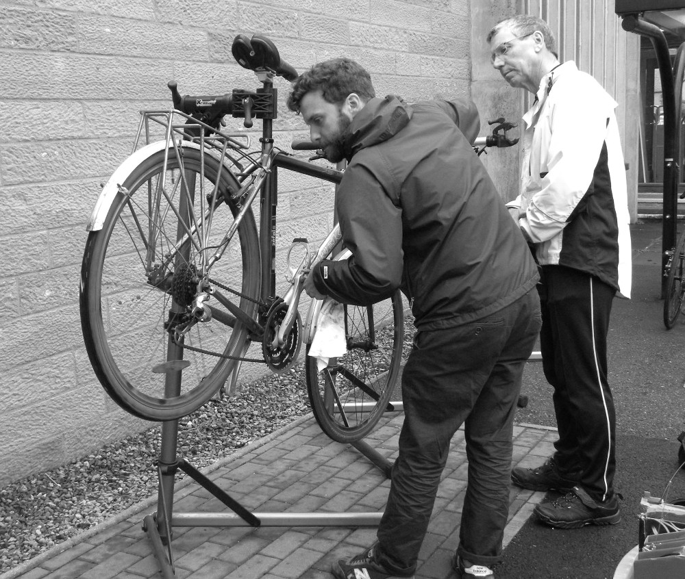 Duncan giving mechanical advice at a Highland Council office