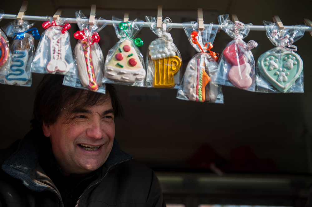 Pablo Scolnik sells dog treats from his truck at the food truck rodeo in Durham Central Park on Sunday Jan. 27, 2013.  The profits go to Paws 4 Ever animal shelter.