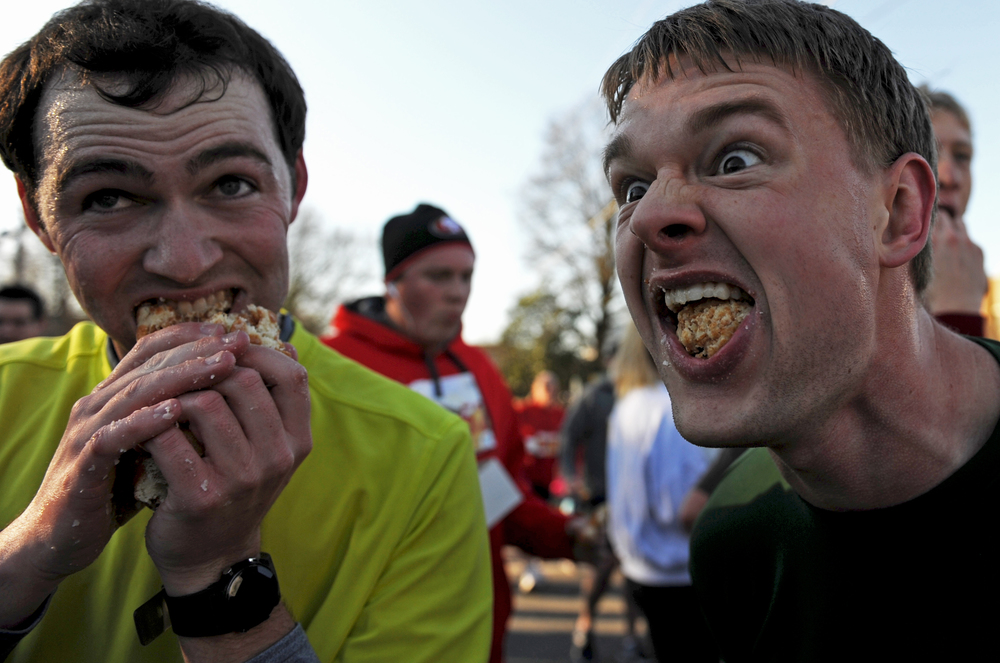 Russell Talley (L) and Jordan Meyers (R) attempt to finish their dozen doughnuts during the Krispy Kreme Challenge in Raleigh, N.C. on Saturday, February 9, 2013.