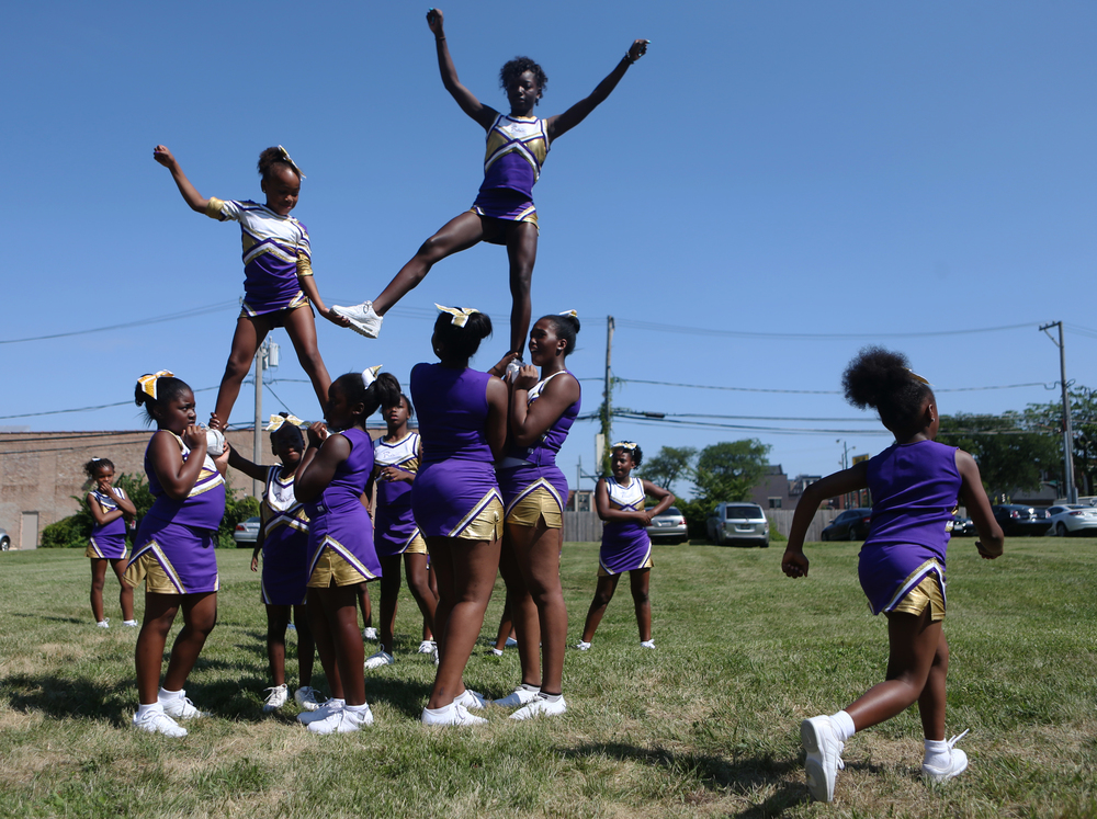 The Extreme Rage All Stars cheerleading team, which is from Milwaukee, WI and consists of girls from four to 18 years, practices before joining the parade route at the Bud Billiken Parade, the oldest and largest African-American parade in the United States, in Chicago on Saturday, August 10, 2013.