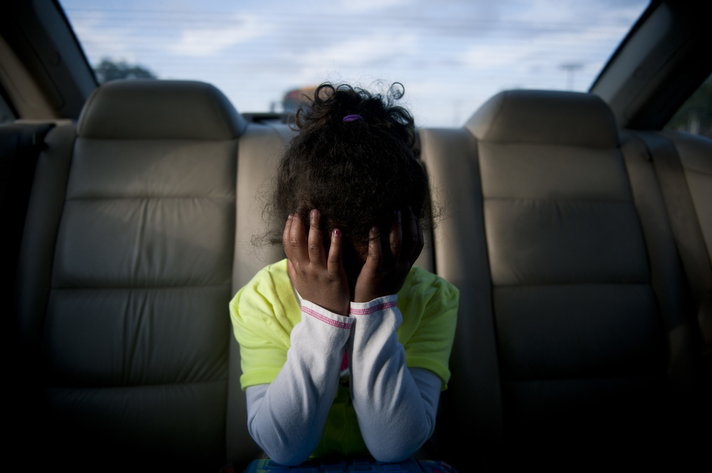 Nevaeh Watson, 5, covers her face during a tantrum in the backseat of her grandmother's car on the way to pick up her brother, Kyle Bradshaw, 14, from school in Tampa.  Nevaeh and Kyle's grandmother, Mary Harris, has taken custody of her two grandchildren, because her daughter, Nicole Harris, was incarcerated the week Nevaeh was born.  I have been following their story for about three months and will continue to document it through Nicole's release from prison in December.  This has been my biggest project and focus during my internship here, so I am greatly looking forward to seeing it come together in the next month.