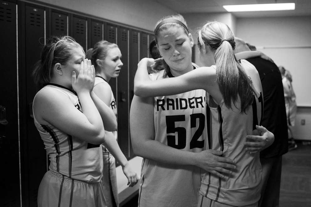 Aubrey Main hugged Paxton Combs in the locker room after the IHSAA girls basketball regional championship in Jasper on Saturday.  Madison defeated Southridge 66-51.