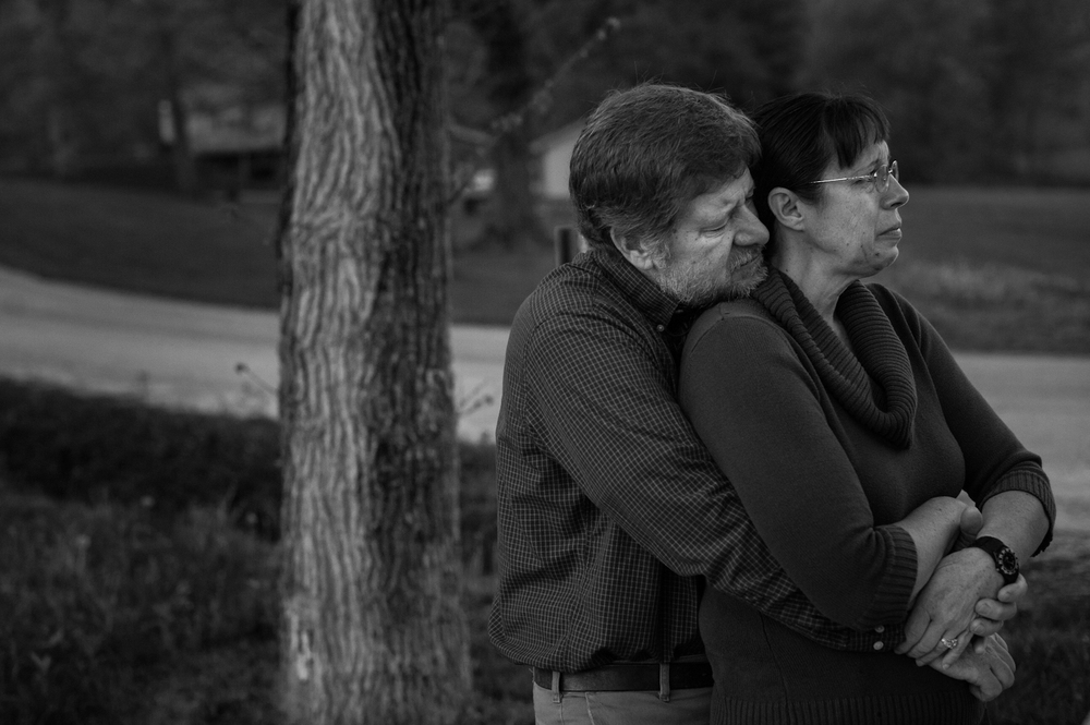 """Doug embraced Janice as Casey's school bus pulled away from their driveway for the last time on May 1. Casey did not come home from school that day, but was picked up by her new caretakers and taken to her new home in Jasper. """"I wonder if she realizes it is the last time,"""" Doug said."""