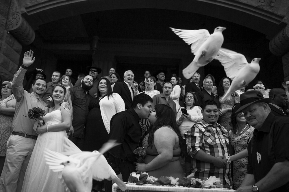 Twenty-five doves were released after one of the free mass wedding ceremonies held annually on the steps of the Bexar County Courthouse on Valentine's Day, Saturday, February 14, 2014.  Over 30 couples were married during that ceremony.