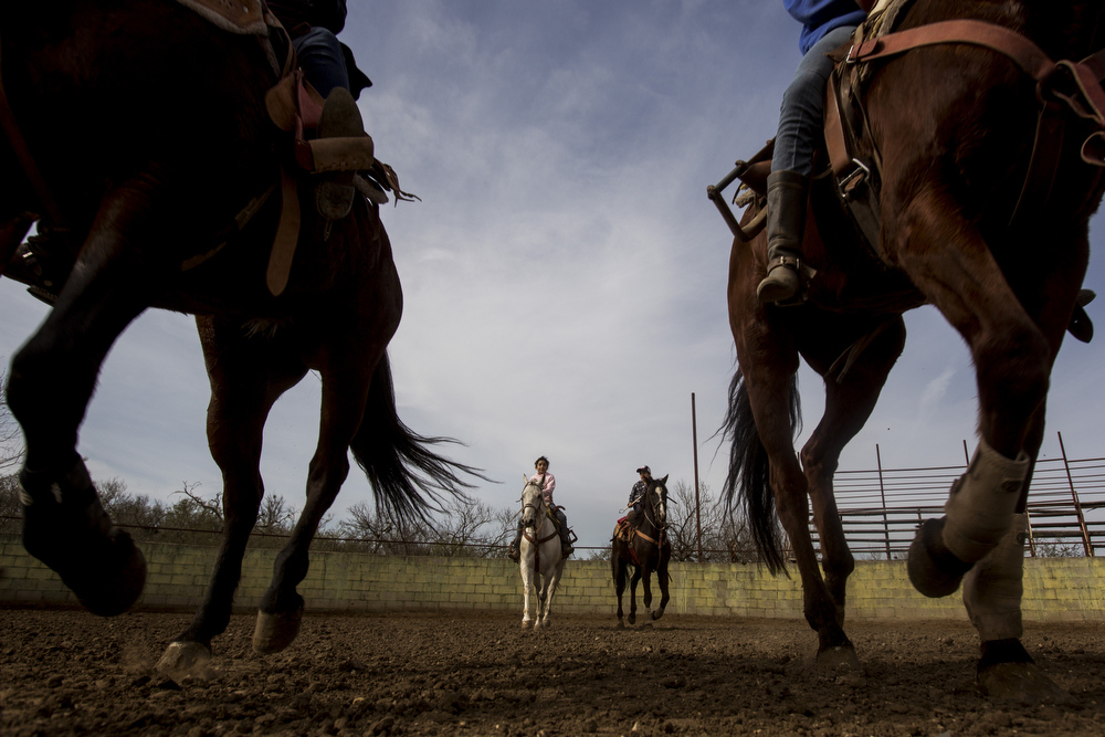 "Miriam Alejandra Montecillos and Emely Ayala canter in formation during practice at La Herradura Ranch in San Antonio, Texas on March 7, 2015.  ""There is nothing else like escaramuza, so we know it is not forever, but we will do it as long as we can,"" Leticia Ozuna, mother of Montecillos and Ayala's teammate Caterina Ozuna, said."