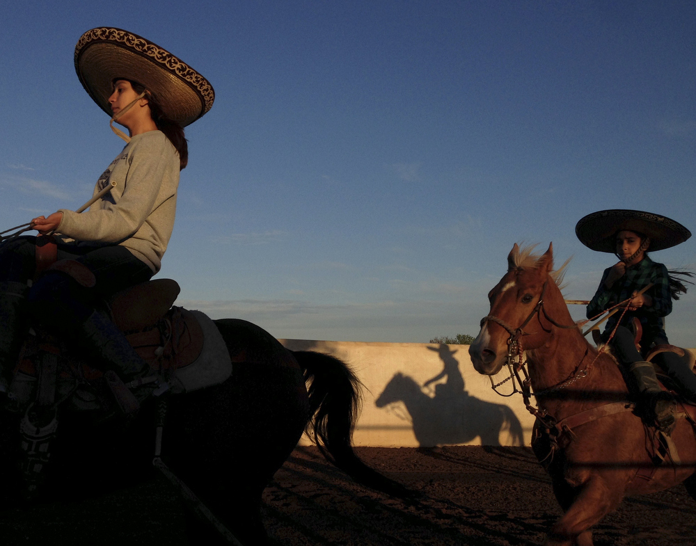 "Caterina Ozuna and Miriam Alejandra Montecillos warm up before practicing their routine for Pre-Estatal at El Rancho Unico in Atascosa, Texas on March 26, 2015.  ""You feel the nerves the moment you go in,"" Ozuna said."