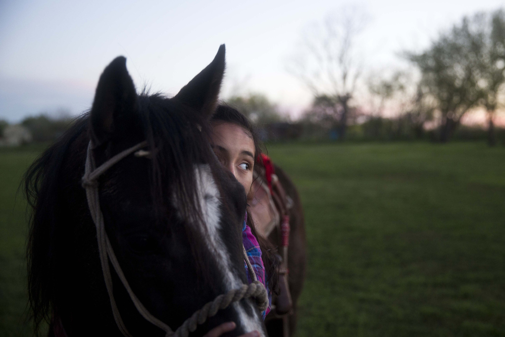 Jackie Ayala hugs her horse Louis Vuitton after practice at El Rancho Unico in Atascosa, Texas on March 26, 2015.