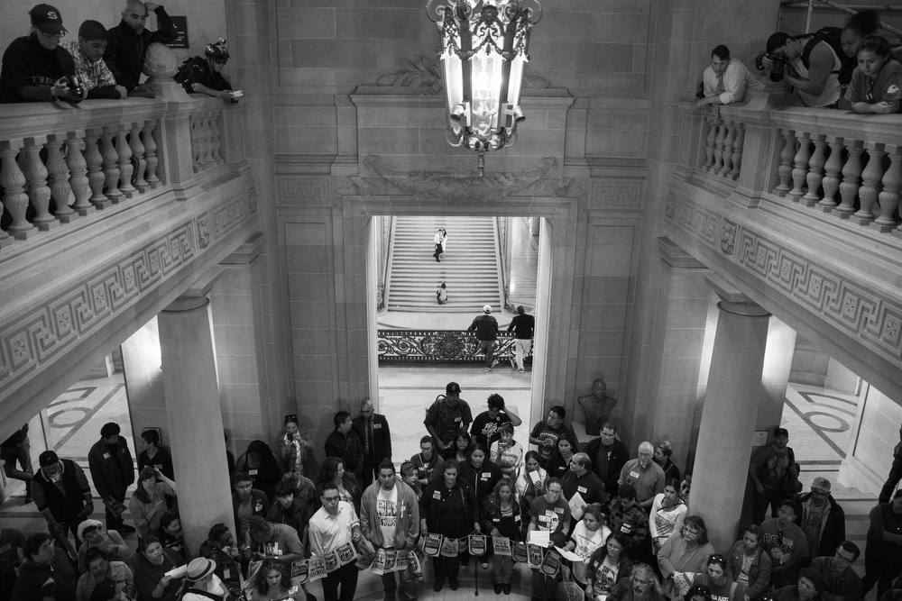 "Supporters of the Mission Moratorium gathered in City Hall in San Francisco, Calif. on June 2, 2015.  Making a plea to his fellow San Francisco Board of Supervisors members, District 9's David Campos said, ""How would you feel to hear from your constituents and hear how powerless they feel?"" Only approximately nine percent of the 500 housing units built in the Mission district in the last five years have been affordable."