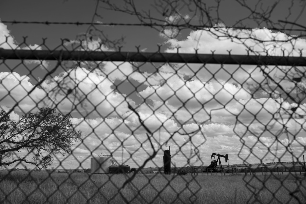 A pump jack stands next to a picnic area outside of LaGrange, Texas on February 19, 2015.