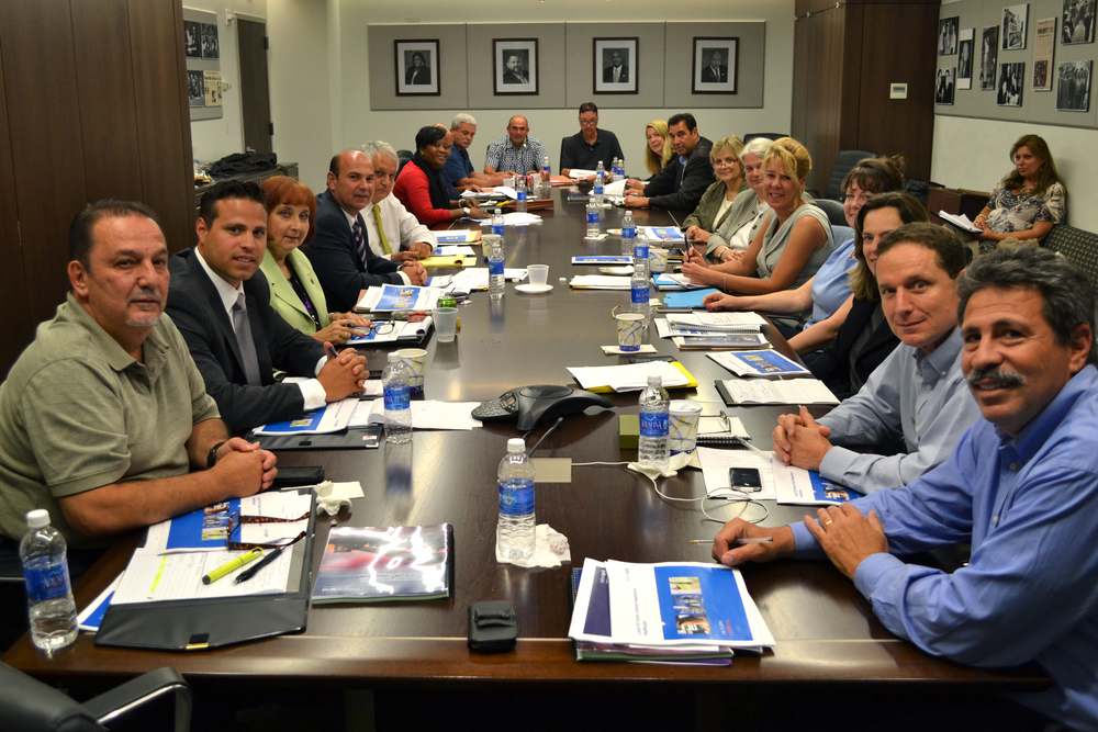 The Local 101 negotiating team (at left) sits opposite management at the Local 101 union hall, in the opening meeting of 2014 contract negotiations.