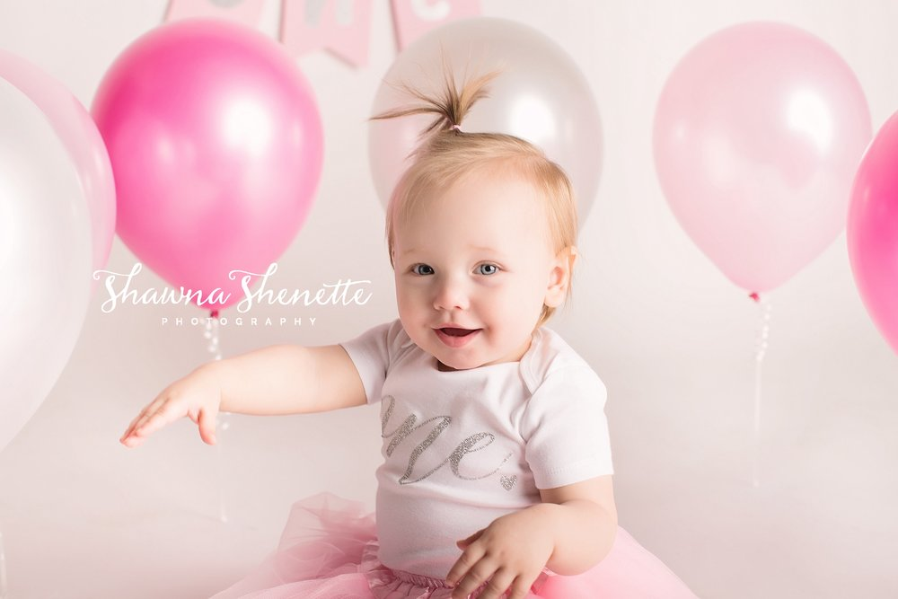 9K8A8993-Edit_Millbury MA Photographer Massachusetts One Year Old Baby Girl Cake Smash Worcester Pink Balloons Pink Boston Metrowest Baby Photos