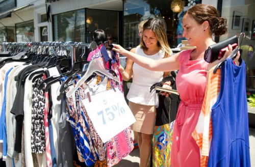 Lauren Gradante, right, and Sarah Bunnell, left, shop at Fred during the Old Greenwich Merchants Sidewalk Sale on Sound Beach Ave. in Greenwich, Conn., on Thursday, June 26, 2014. Photo: Lindsay Perry