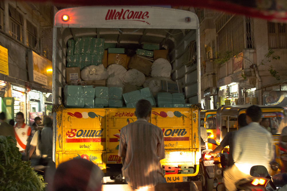 Millions of goods are exchanged all over the city on bikes, trucks, cows, and many other means of travel